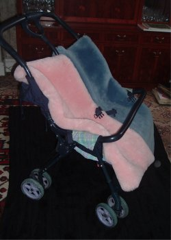 Baby blue and Pink shaped Cozifleece fleeces in a double buggy
